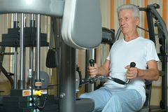 Elderly man in  gym. Elderly man in a gym during exercise Royalty Free Stock Images