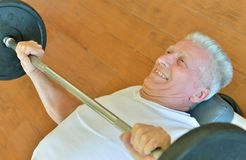 Elderly man in a gym Stock Images