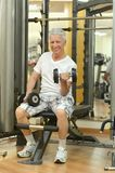 Elderly man in a gym. Stock Photography