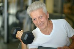 Elderly man in a gym Royalty Free Stock Image