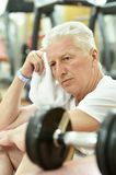 Elderly man in a gym Royalty Free Stock Photo