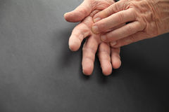Elderly man with hand pain stock photos