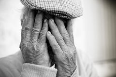 Elderly man with hands on face Royalty Free Stock Photos