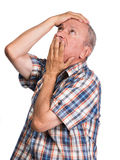 Elderly man with hands near his face looking up Royalty Free Stock Photography