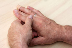 elderly man has pain in fingers and hands Royalty Free Stock Photography