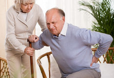 Elderly man having a back pain Royalty Free Stock Photo