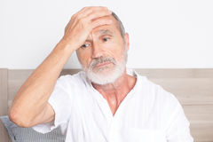 Elderly man having a headache Stock Photos