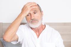 Elderly man having a headache Stock Photos