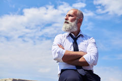 Elderly man having his arms folded Royalty Free Stock Images