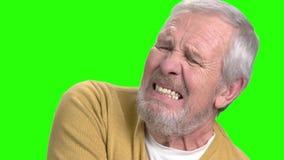 Elderly man having shoulder pain. Senior man suffering from arthritis on chroma key background stock video