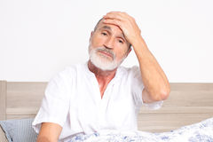 Elderly man having a strong headache Royalty Free Stock Photos