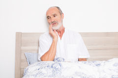 Elderly man having toothache royalty free stock images