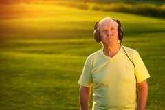 Elderly man in headphones. Royalty Free Stock Photo