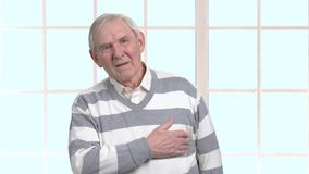 Elderly man with heart-attack. Old man having cardiac arrest. How to prevent heart-attack. Difference between cardiac arrest and heart attack stock footage