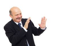 Elderly man is hiding from danger. Royalty Free Stock Images