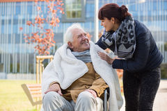 Elderly man and his daughter. Photo of elderly men and his caring daughter Stock Photography