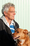 Elderly man with his dog Stock Image