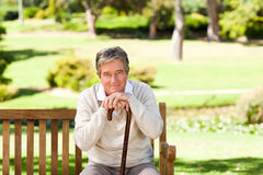 Elderly man with his walking stick Royalty Free Stock Images