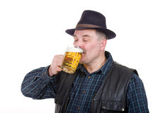 Elderly man holding a beer belly Stock Photography
