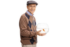 Elderly man holding a bowl with a goldfish Stock Image