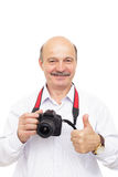 Elderly man is holding a camera and shows thumb up Stock Image