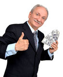 Elderly man holding dollars Royalty Free Stock Photography