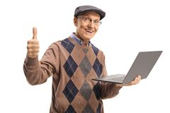 Elderly man holding a laptop computer and showing thumbs up royalty free stock photo