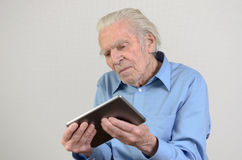 Elderly man holding a modern tablet PC Royalty Free Stock Images