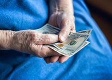 Free Elderly Man Holding Money In His Hand Royalty Free Stock Photos - 158658108