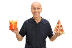 Elderly man holding pizza and fries Royalty Free Stock Image