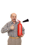 Elderly man is holding a red fire extinguisher. Royalty Free Stock Photos