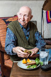 Elderly Man Holding Sandwich Royalty Free Stock Photos