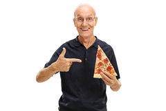 Elderly man holding a slice of pizza Stock Photography