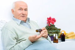 Elderly man holds his medicine vial Stock Photography