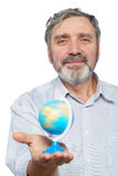 Elderly man holds small globe in his hand Royalty Free Stock Image