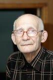 Elderly man indoor portrait Stock Photos