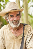 Elderly man. JAPERI, BRAZIL - NOVEMBER 11, 2013: Elderly man on a rural community smiles while waiting the governmental ceremony for the issuance of land Royalty Free Stock Photos