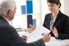 Elderly man during job interview. View of elderly men during job interview Stock Images