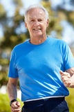 Elderly man jogging Stock Photo