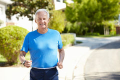 Elderly man jogging Royalty Free Stock Images
