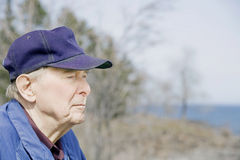 Elderly man by lake Royalty Free Stock Photos