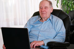 Elderly man on laptop Stock Photo