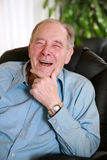Elderly man laughing Royalty Free Stock Photos