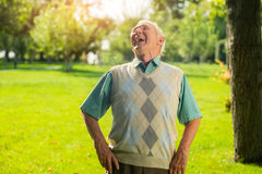 Elderly man is laughing. Royalty Free Stock Image