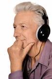 Elderly man listen to music in headphones Stock Photo