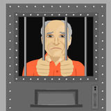 Elderly man looking from behind bars Stock Photo