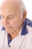 Elderly man looking down depressed Stock Photo
