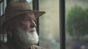 Elderly Man Looking Out Window stock footage