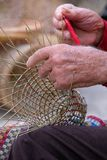 Elderly man makes baskets for use in the fishing industry in the traditional way, in Gallipoli, Puglia, Italy. Gallipoli, Italy. Elderly man makes baskets for royalty free stock image