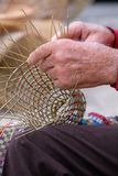 Elderly man makes baskets for use in the fishing industry in the traditional way, in Gallipoli, Puglia, Italy. Gallipoli, Italy. Elderly man makes baskets for royalty free stock images